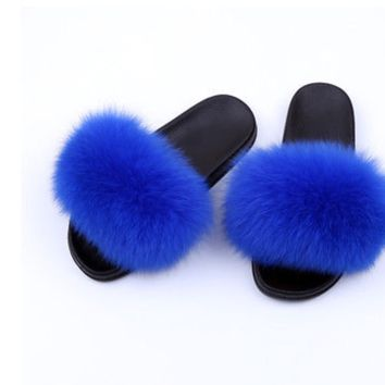 Royal blue fox fur slides