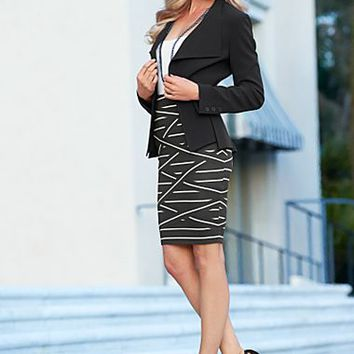 Black Fish tail jacket, cami, criss cross banded skirt, heel  from VENUS