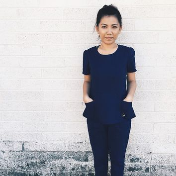 The Peplum Top in Estate Navy Blue - Medical Scrubs by Jaanuu