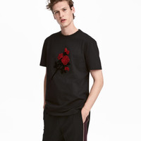 H&M T-shirt with Embroidery $29.99