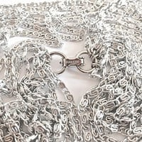 Signed Light and Comfortable Vintage Sarah Coventry, Sparkling Silvery Cascade Necklace with 8 Bent Link Strands, Multi Chain Choker