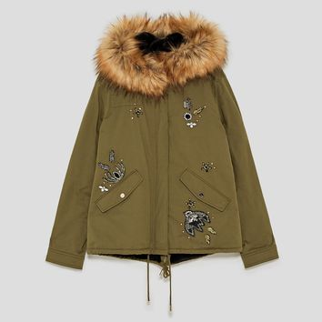 SEQUINNED PARKA WITH PATCHES