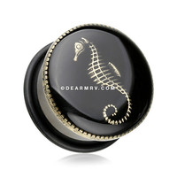 A Pair of Golden Seahorse Capped Inlay Blackline Ear Gauge Plug