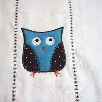 Embroidered burp cloth with an applique retro owl in blue, brown and white. Can be personalized for an extra charge.