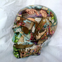 Large ceramic skull covered in recycled avengers comic book tea light cover