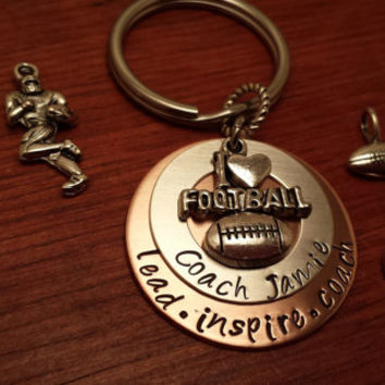 "Hand stamped football coach's key chain with saying. ""lead, inspire, coach"""