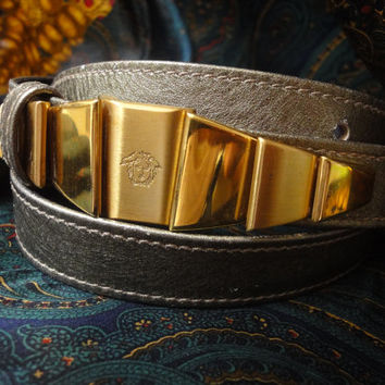 Vintage Gianni Versace skinny gold bronze leather belt with golden hardware and medusa.  Size from 25, 26, 27 inch. Lady Gaga look.