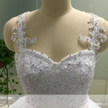 Ball Gown Spaghetti Straps Beaded Backless Wedding Dresses with Bow Knot Appliques Gowns
