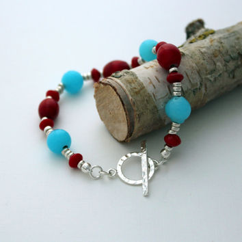 Sterling silver toggle clasp 'blushing' bracelet with red and turquoise beads on silver plated wire