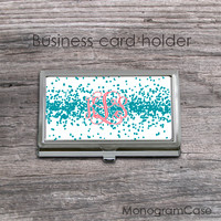 Business card holder with coral monogram teal dots background