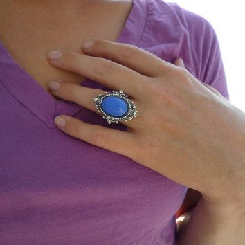 dark blue glass scarab ring in silver