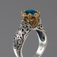 The ENCHANTED PRINCESS engagement ring with London Blue Topaz in silver and 14k gold