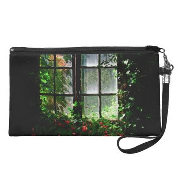 A cottage garden window with flowers and plants wristlet purse