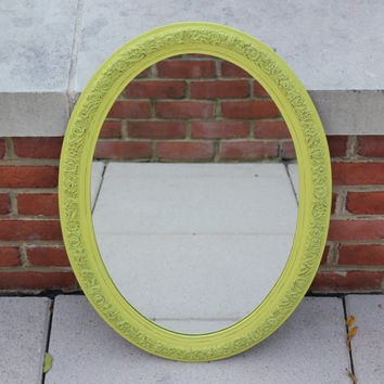 Antique looking yellow and gold oval wall mirror
