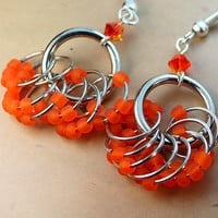 Funky unique earrings - bright frosted fire orange glass ringed ladies earrings