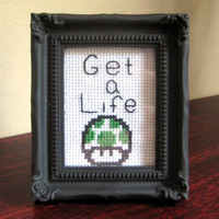 Get A Life  Finished Black Framed Cross Stitch by ThemDryBones