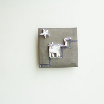 White cat wall hanging, ceramic cat in grey background, square shaped wall tile of stoneware and porcelain