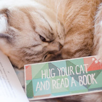 "Handmade funny Pet Cat Bookmark with a message ""Hug your cat and read a book"""
