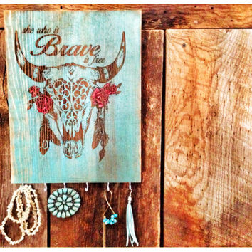 Wall jewelry organizer Steer skull with She who is Brave is free quote on distressed turquoise wood 6 hooks