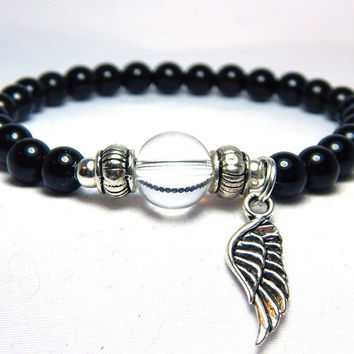Spiritual Bracelet with an Angel Wing Charm and Black Onyx