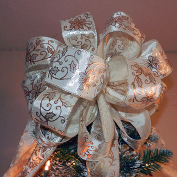 Large Christmas Tree topper bow made of an Ivory ribbon with gold and silver shiny Christmas flowers