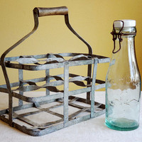 vintage French zinc bottle carrier with wooden handle, holds 6 bottles