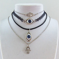 Hamsa hand and evil eye chokers and necklaces in metal chain leather and stretchy tattoo hand of fatima all seeing eye 3rd eye boho
