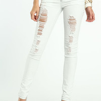 SHREDDED WHITE SKINNY JEANS