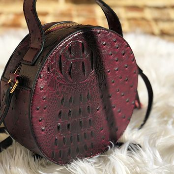 NARNI OSTRICH EMBOSSED ROUND BAG - WINE