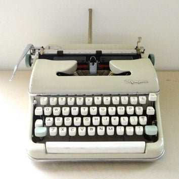Olympia typewriter SM5 a wonderful working typewriter in cream and pale turquoise