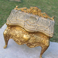 Vintage gilded  casket jewelry box on legs by clcort