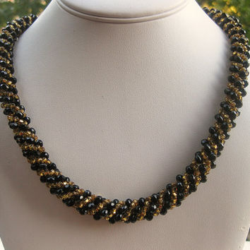 Spiral rope black and golden necklace