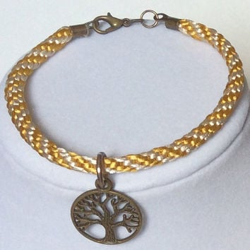 "Braided bracelet, Rope Bracelet, Kumihimo Bracelet, Stackable Bracelet In Cream & Gold w/ Antique Gold Tree - Of - Life Charm - 7 3/4"" Long"