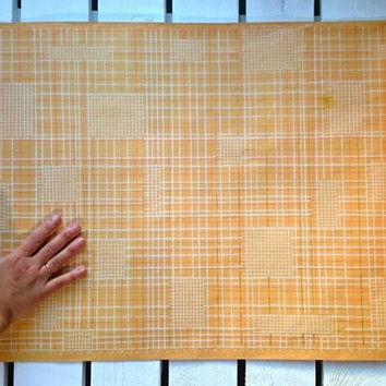 Retro vintage Soviet era wallpaper from the 1970s with checkered patterns and orange-red, light brown and white details