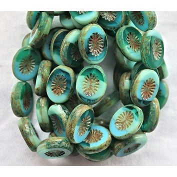 Ten 14 x 12mm flat oval Czech glass kiwi beads, opaque and transparent turquoise blue green picasso table cut, carved front & back C19101