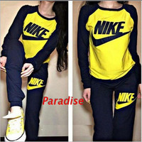 NIKE YELLOW RED TWO PIECE SPORTS WEAR