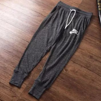 NIKE 2018 new women's thin section knit casual cropped trousers closed mouth pants F0664-1 Gray