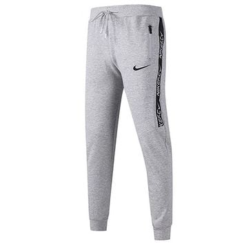 NIKE 2018 autumn and winter new sports fitness men and women models trousers training casual pants grey