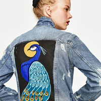 DENIM JACKET WITH PEACOCK PRINT DETAILS