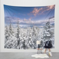 """Mountain light"". Snowy forest at sunset Wall Tapestry by Guido Montañés"