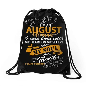I'm an august woman I was born with my heart Drawstring Bags