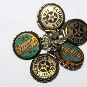 Collection of Five Vintage Kork-N-Seal bottle caps with advertising for Gluek's Beer, Schmidt's Beer