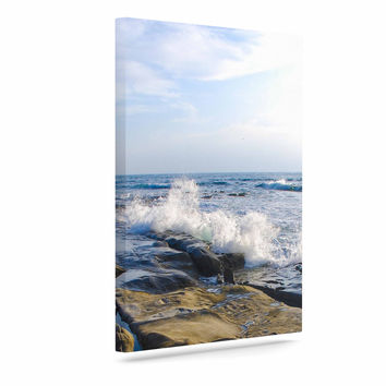 "Nick Nareshni ""Wave Against Rocks"" Brown Blue Canvas Art"