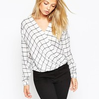 ASOS | ASOS Drape Wrap Blouse in Mono Check at ASOS