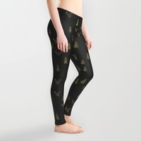 Looking for winter deer and pine trees Leggings by Jennifer Rizzo Design Company