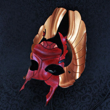 Red, black and bronze Egyptian scarab leather mask.