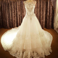 Luxuriously Beaded Crystal Sleeveless O-neck Cathedral Train Wedding Dress