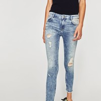 MID-RISE POWER STRETCH JEANS