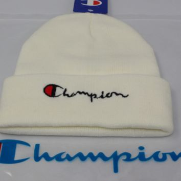 Champion male and female alphabet embroidery knit couple student woolen cap Beige