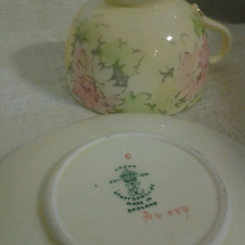 Floral Crown Staffordshire Tea Cup and Saucer made of Fine China